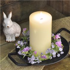 """Candle ring featuring a profusion of realistic purple flowers and yellow buds; approx. 8"""" diameter with a 3"""" center. #country #decor #artificial #spring #flowers"""