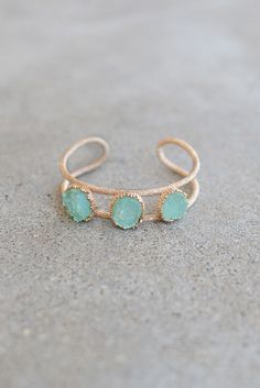 Montauk Gem Bracelet - Mint from Page 6 Boutique | You need this BLING! This versatile textured gold bracelet features three slightly opaque mint colored, druzy stones. Gems featured crown like framework. Adjustable bangle bracelet perfect for stacking. Your jewelry collection is in dire need of an addition this perfect! Lead and Nickel Free.