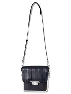 Who needs snake or lizard when you can have an eel bag? That's right, eel. We won't lie, we're a little obsessed. @Theyskens' Theory