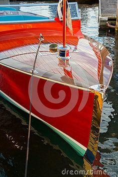 Vintage wooden boat moored alongside resort dock