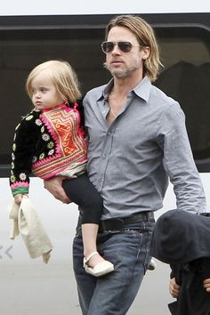 13 Ovary-Tickling Pictures of Hot Guys Holding Babies: Brad Pitt