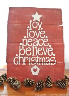 Use carbon paper to transfer a seasonal message onto a Christmas pallet sign.