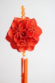 Orange origami kusudama flower ball.