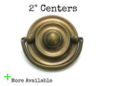 This listing is for 1 vintage ornate drawer pull with both screws -Nice brass colored metal patina -Measurements: just under 2.75 wide, 2.5 tall, 2 centers (from the center of one screw hole to the center of the other) RARE SIZE  Check out the hardware sections of my store for more pull and knob options.  See more ornate and French Provincial pulls here: https://www.etsy.com/shop/Fairyhome?section_id=8156245&ref=shopsection_leftnav_1  Location: P