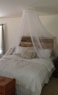 """DIY mosquito net canopy.  18"""" embroidery hoop and 4 110""""x 98"""" Lill sheers from IKEA ($5.00 for a pair).  Tie a ribbon, or string, across from one side to the other then hang from ceiling with a self screwing hook.  Cheap and easy romance!"""