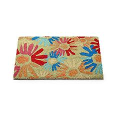 It's okay to step on these flowers—in fact, we encourage it. A fun, colorful floral motif is stenciled on our exclusive, rugged doormat, ready to extend a warm-weather welcome to you and your guests. Natural tufted coir mat has a PVC backing to prevent slipping.
