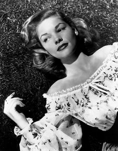 Bacall. In the grass.