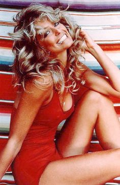 Rumor had it that the curls in Farrah Fawcett's hair spelled 'SEX'. You can see the letters beginning at her shoulder and continuing across the base of her neck.
