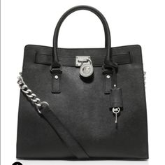 Michael Kors Hamilton Tote - authentic *REDUCED!* Michael Kors Black Leather Hamilton Tote with silver accents. Has shoulder strap and handles, interior pockets and keychain clip. Used for one season. Two small stains inside (pictured). Can share more photos if needed. Will accept offers. *Dust bag included!* Posted on other sites code KPHAM. ♏️ Michael Kors Bags Totes