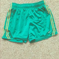 Nike athletic shorts Nike mesh shorts, perfect for the gym or lounging. Not super tight fitting. Nike Shorts