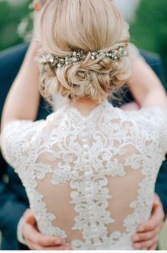 twisted wedding updo hairstyle with baby's breath