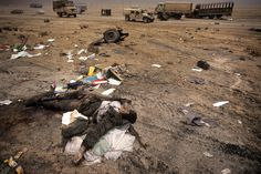 """Kuwait . Liberation of Kuwait City . At the exit of the city , the road to Basra was called """"highway of death"""" where U .S . aicrafts bombed retreating Iraqi forces . An Iraqi soldier corpse . February 1991"""