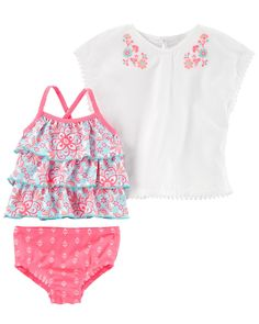 She's beach-ready in this ruffle tankini and matching cotton coverup!