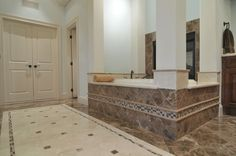 Play around with different bathroom tiles for unique patterns and a sophisticated look.