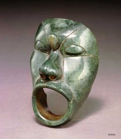 Maya. Jade. height approximate. 14 cm. Mosaic head of screaming prisoner. Probably a belt mask.