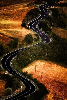 Bends by Photos On The Road The Crete Senesi refers to an area of the Italian region of Tuscany to the south of Siena. It consists of a range of hills and woods among villages and includes the comuni of Asciano, Buonconvento, Monteroni d'Arbia,. Beautiful Roads, Beautiful Places, The Road, Winding Road, Tuscany Italy, Siena Italy, Sorrento Italy, Naples Italy, Sicily Italy