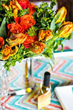 Colorful Rehearsal Dinner Inspiration - Bellwether Events Washington DC Wedding Planner orange centerpiece chevron olive oil favor