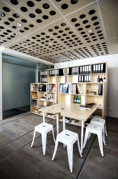 Fold-down desks and mobile workstations allow Australian firm Particular Architects to regularly reconfigure the layout of their studio space in Melbourne.