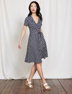 All the effortless appeal of a shirt dress, none of the fuss of a collar. We've taken casual shirting fabric and crafted it into this easy-to-wear wrap style, with a flattering A-line skirt. And there's more good news: it has pockets, too.