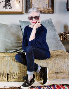 Linda Rodin- like the navy blue with her hair. I don't think you need sunglasses inside. Not sure about the shoes or socks.