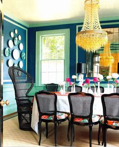 The colors with the chandelier are so nice.  The large chair and plates? No.