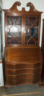 VINTAGE 1930 TO 1940 MAHOGANY SLANT FRONT SECRETARY DESK BOOKCASE WITH WITH 3 WOOD SHELVES AND 4 DRAWERS. WHEN DESK IS PULL DOWN, IT OPENS UP INSIDE WITH 6 FILE COMPARTMENTS AND 5 DRAWERS. MEASURES 33 X 19 X 79. IS MISSING FINIAL.
