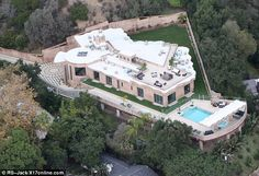 Well hidden: Aerial shots of the magnificient mansion show the sprawling grounds which are surrounded by mature Oak and Sycamore trees
