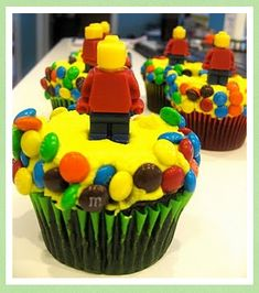 Lego cupcakes. I like the mini m's. Could work with any other topper.