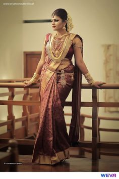 South Indian bride. Gold Indian bridal jewelry.Temple jewelry. Jhumkis Maroon and gold silk kanchipuram sari.Braid with fresh flowers. Tamil bride. Telugu bride. Kannada bride. Hindu bride. Malayalee bride.Kerala bride.South Indian wedding.