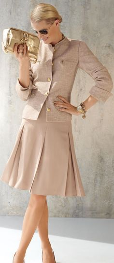 A jacket & pleated skirt of cream with a hint of peach a lovely way to do monochromatic.