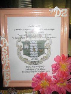 I like the idea od framing the crest/symphony and the little ribbons are adorable!