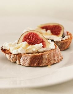 Sweet fig crostini is so easy: Simply broil buttered baguette slices, then spread on ricotta, drizzle with honey, and top with a fig. Done!    #party #appetizers