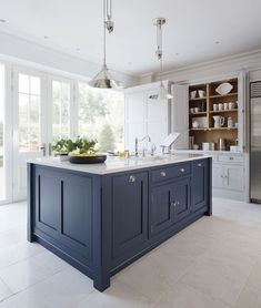 I saw a great example of a muted navy kitchen island with white kitchen cabinets. I saw a great example of a muted navy kitchen island with white kitchen cabinets that would look fab with your dining table (refreshed with a darker stain, pale gray line Marble Kitchen Counters, Blue Kitchen Island, White Kitchen Cabinets, Kitchen Flooring, Gray Cabinets, Island Blue, Kitchen Grey, Shaker Cabinets, Kitchen Islands