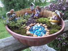 Use blue glass pebbles for a pond when you craft your own adorable fairy garden.