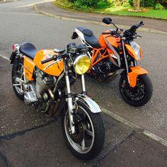 Jota beside my mates KTM rocket.  KTM know orange is the best colour.  And I love how his headlamp unclips then turns into a wee portable dust hoover :)   #ktmsuperduke #ktm #jota #laverdajota #laverda