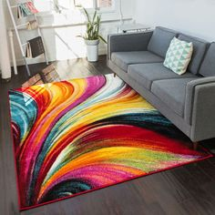 Bright, multi-colored lines swirl freely across a rug equally at home in the modern living room or playroom.