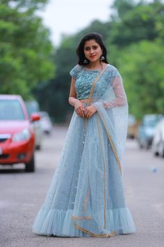 Stunning floral lehenga and maroon blouse with blue color net dupatta. Lehenga with gold jari boarder. Blouse with hand embroidery work and jari sleeves. To order whatsapp Indian Gowns Dresses, Indian Fashion Dresses, Girls Fashion Clothes, Skirt Fashion, Indian Outfits, Prom Dresses, Fashion Outfits, Long Skirt Top Designs, Long Skirt And Top