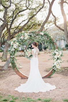 Floral Circle Arch | illusion back wedding dress | anemone bouquet | kale flower bouquet | circle ceremony arch | Blush and Grey Garden Party Wedding Inspiration at Hyatt Regency Hill Country Resort in San Antonio Texas by Allison Jeffers Wedding Photography 0041