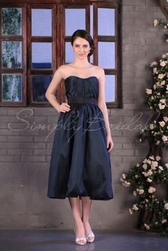 Wedding Dress by SimplyBridal. This dress is shown in Evergreen.This cute A-line dress with a natural waistline is certainly a unique wedding frock. The large pleats across the bodice make for a gorgeous look and the hidden pockets are an added bonus making this dress perfect for the p. USD $161.99