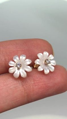 Custom made mother of pearls flower diamond gold earrings.