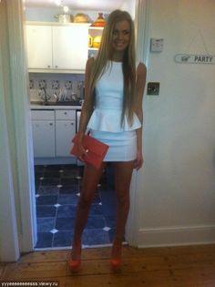 "Peplum white mini dress + coral heels n clutch, cute grad attire minus the ""bust my ass on stage"" heels"