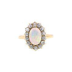 Google Image Result for http://ringoblog.com/wp-content/uploads/2010/10/opal-rings-with-diamonds.jpg