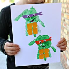 Make these awesome handprint ninja turtle craft for kids! All you need is paint, googly eyes, and paper! It's a fun art project for boys to make.