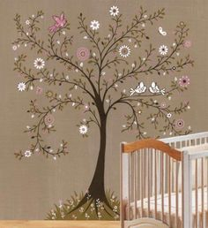 Sweet nursery idea - tree mural with blossom: Add some hooks to the tree and use it for storage.