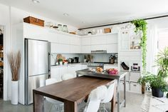 As soon as guests walk in, they enter into the expansive kitchen. They added an extra prep table at the end of the dinner table, the UTBY Bar from IKEA.