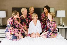 Cute getting ready bride and bridesmaid posing - Natalie Franke Photography (Love the getting ready robes)