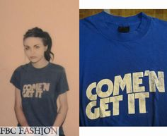Frances Bean Cobain wears a Vintage 80s Come 'N Get It (dog food slogan) T-Shirt in the color Blue.