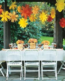 These flowers are made from colored paper bags. A fun (and inexpensive) idea for a young lady's graduation party.