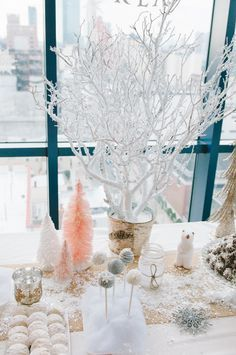 #winter, #branch, #diy, #dessert-table, #birthday-party, #party-decor, #winter-wonderland, #party-theme  Photography: Ardita Kola Photography - arditakola.wordpress.com/  Read More: http://www.stylemepretty.com/living/2014/03/13/winter-wonderland-1st-birthday-party/