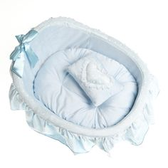 Beautiful blue cradle style bed for dogs. www.calvinknine.com